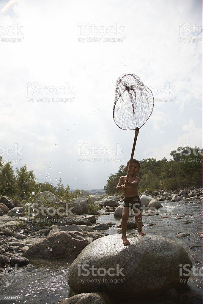 Japanese kid on river royalty-free stock photo