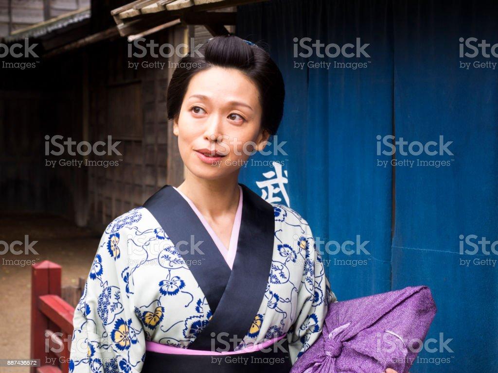 Japanese kimono woman walking on the old town. stock photo