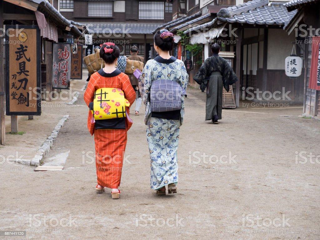 Japanese kimono women walking on the old street. stock photo