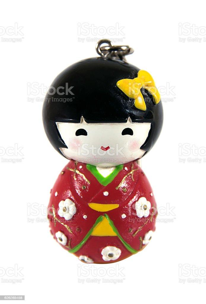 Japanese kokeshi dolls with key ring made of wood isolated stock photo