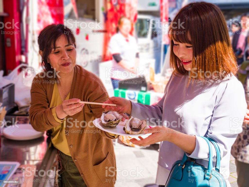 Japanese ladies at the front of the food truck. royalty-free stock photo