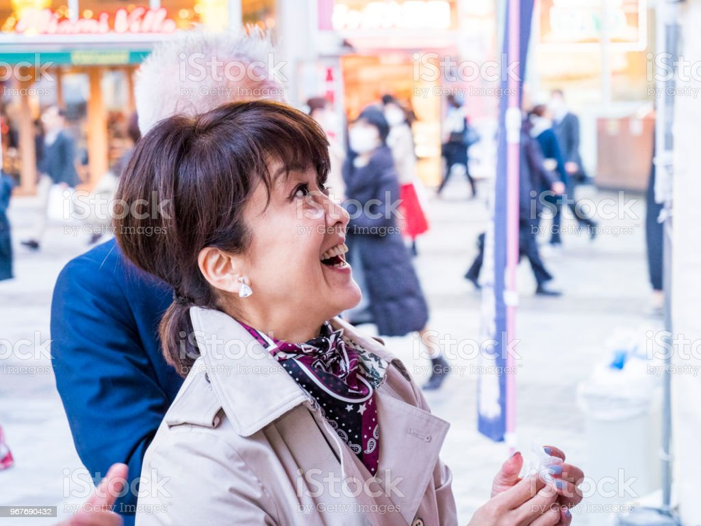 japanese lady ordering her foods to food truck. stock photo