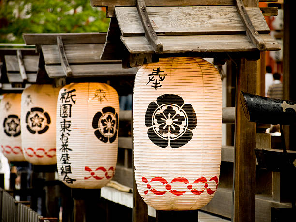 Japanese lanterns Japanese lanterns hanging during the Gion Matsuri festival in Kyoto shinto stock pictures, royalty-free photos & images