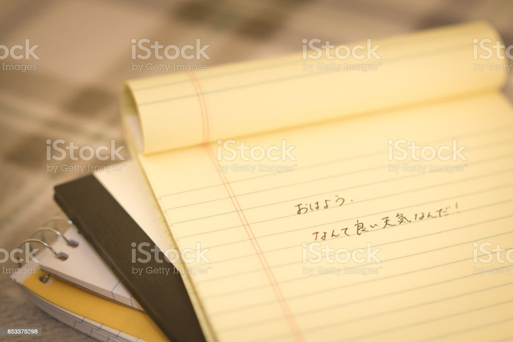 Japanese learning new language writing greetings on the notebook japanese learning new language writing greetings on the notebook translation good morning m4hsunfo