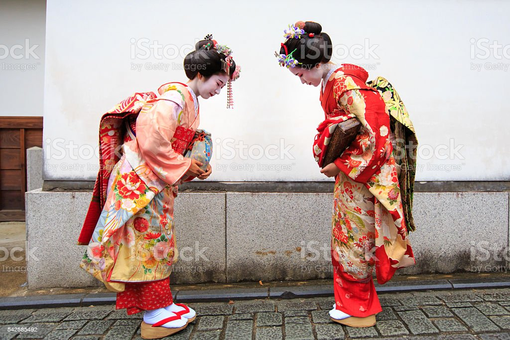 Japanese Maiko girls bowing each other stock photo