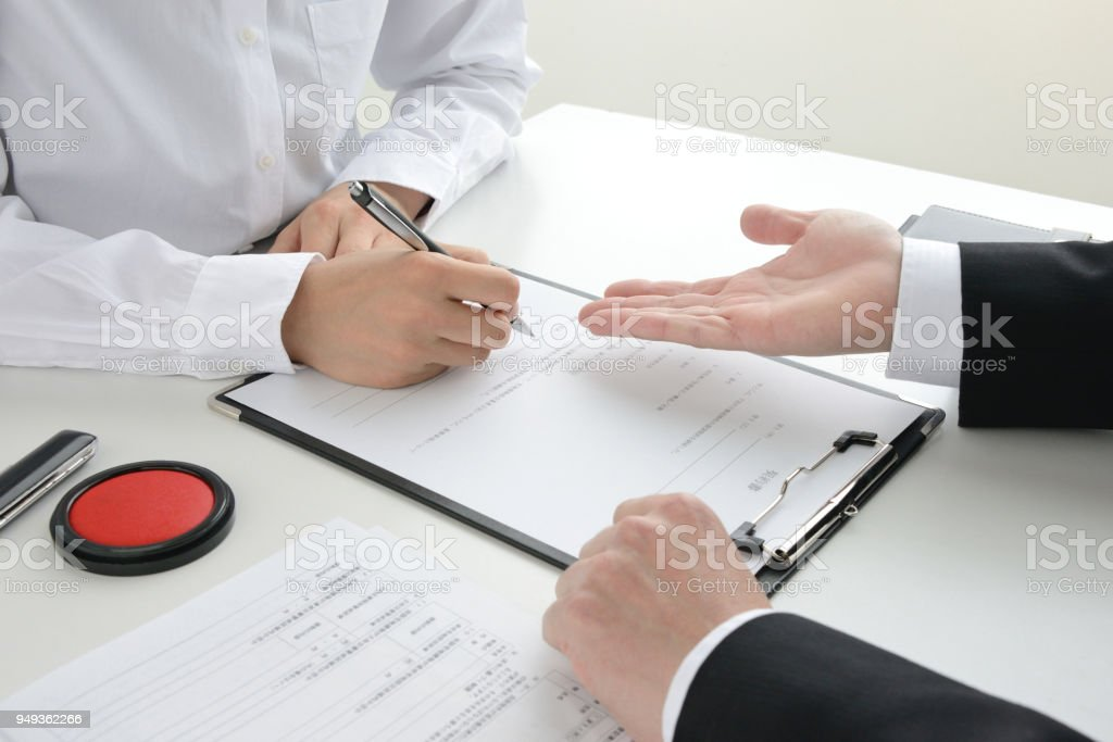 Japanese making contract scene stock photo