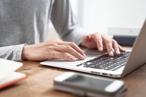 Japanese male businessman working from home in plain clothes Japanese male businessman working from home in plain clothes using laptop stock pictures, royalty-free photos & images