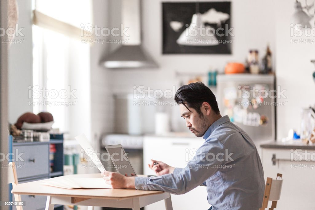 Japanese man at home office stock photo