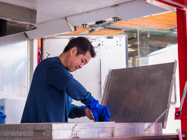 Japanese man cooking at the food truck. stock photo