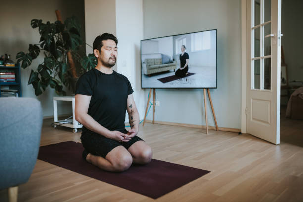 japanese man exercising at home - meditation stock pictures, royalty-free photos & images