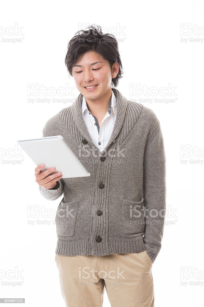 Japanese man holding a digital tablet foto royalty-free