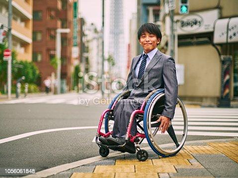 A Japanese man in a wheelchair, in Tokyo Japan.