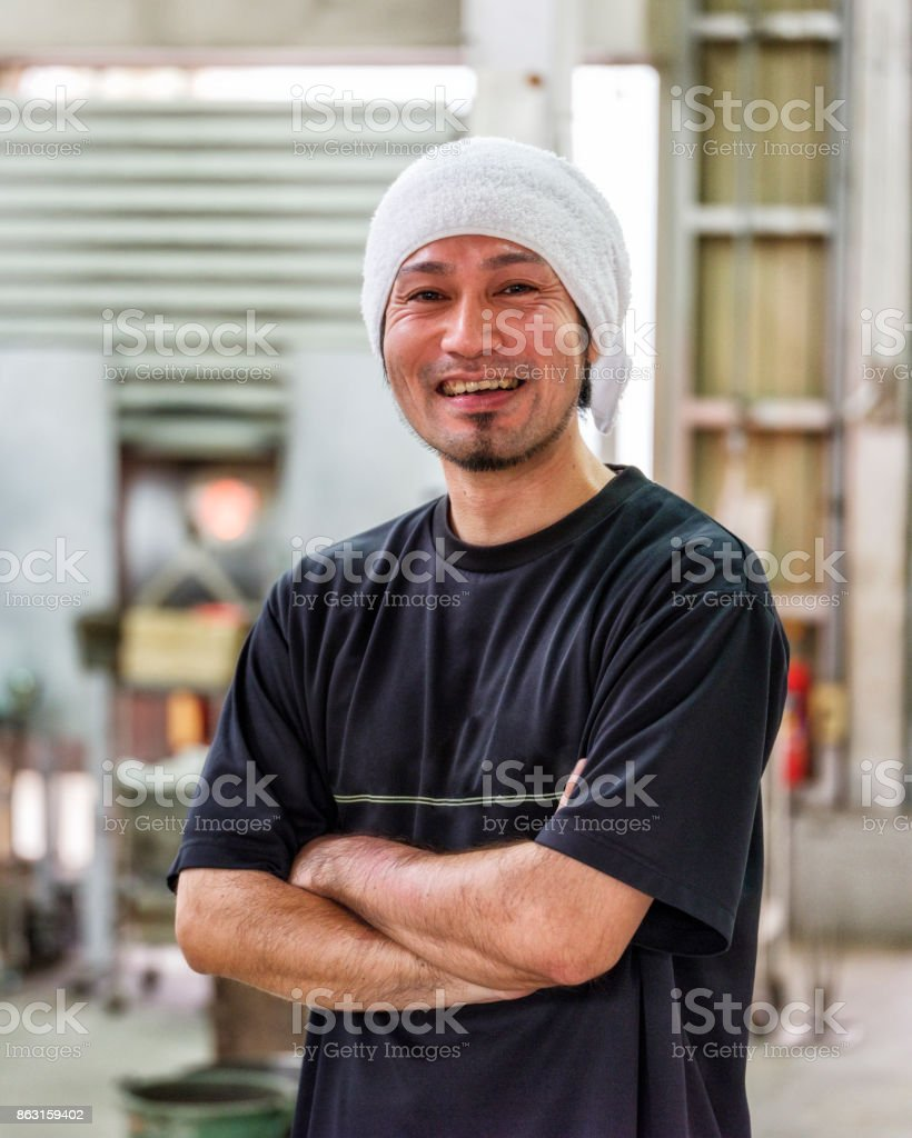 Japanese Man in Glass Blowing Factory stock photo