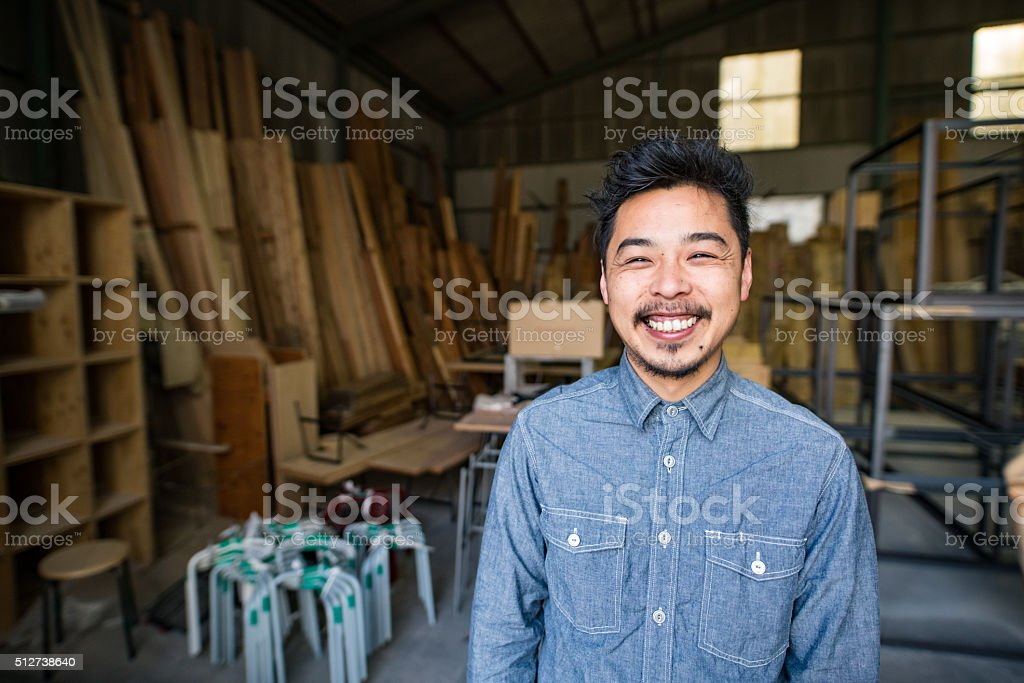 Japanese man in his thirties in a small business environment stock photo