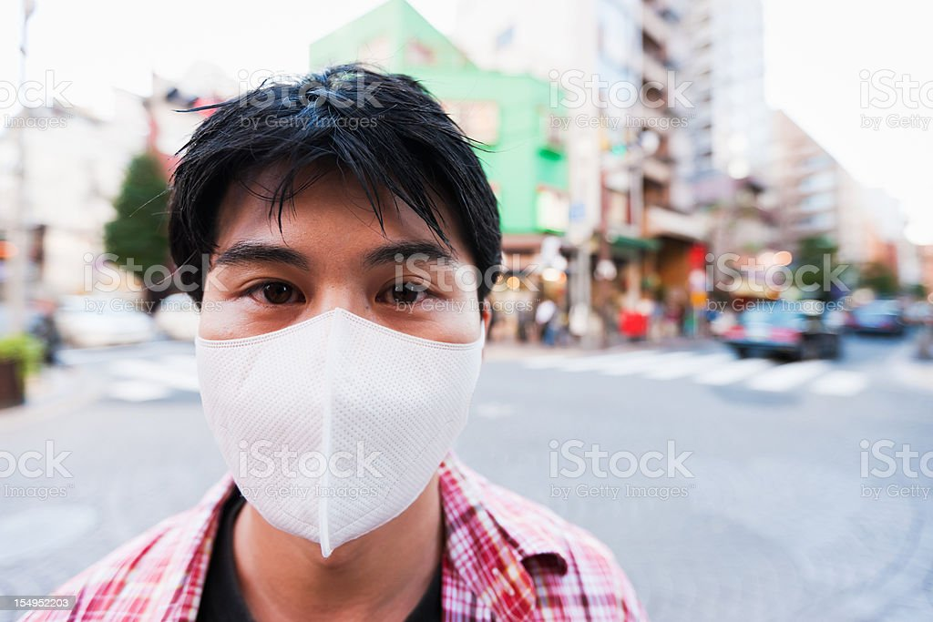 Japanese Man in Tokyo with Facial Protection Mask royalty-free stock photo