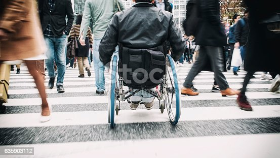 istock Japanese Man in Wheelchair 635903112