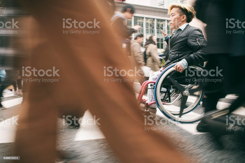 Japanese Man in Wheelchair royalty-free stock photo