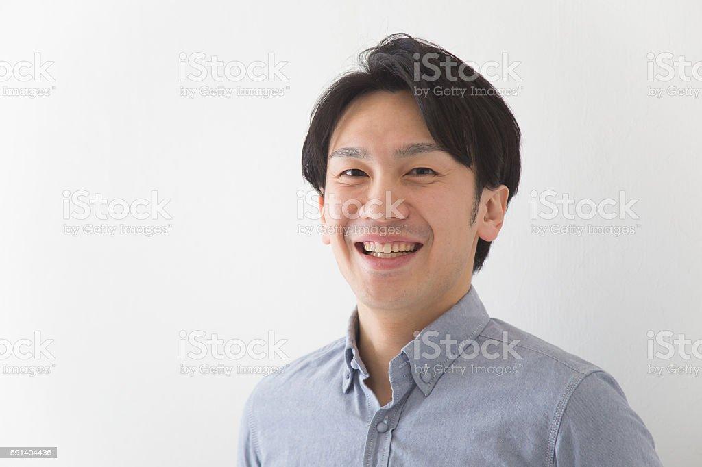 Japanese man looking at camera stock photo