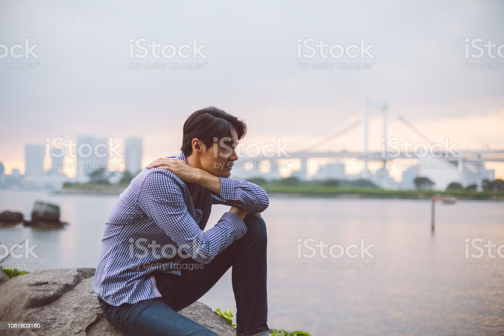 Japanese man looking at view Young man staring into the distance 30-34 Years Stock Photo