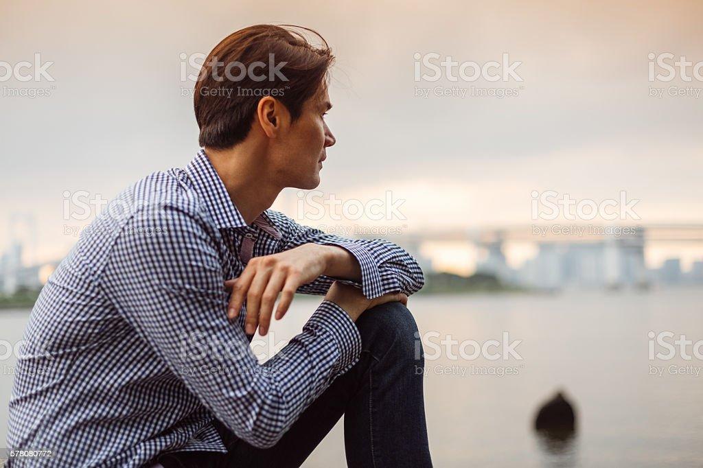 Japanese man looking at view stock photo