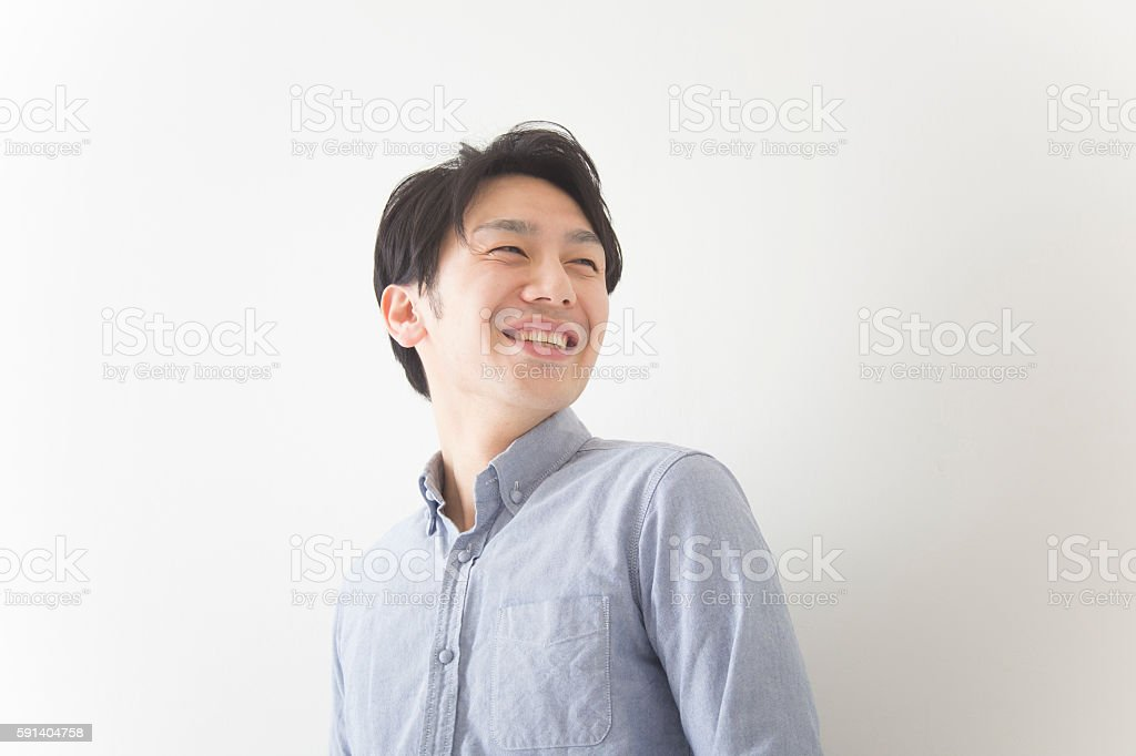 Japanese man looking away from camera stock photo