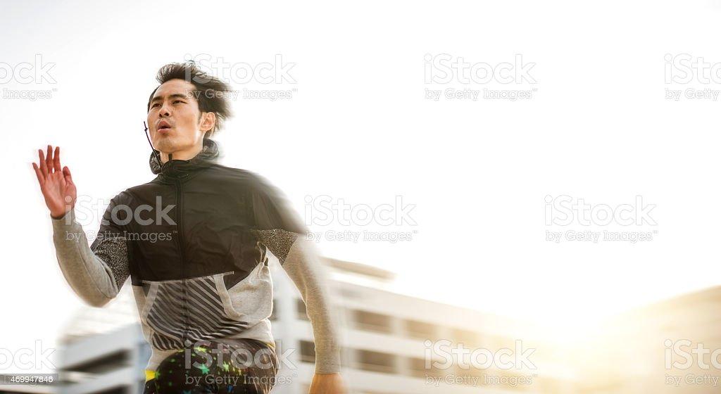 Japanese man running on the city stock photo