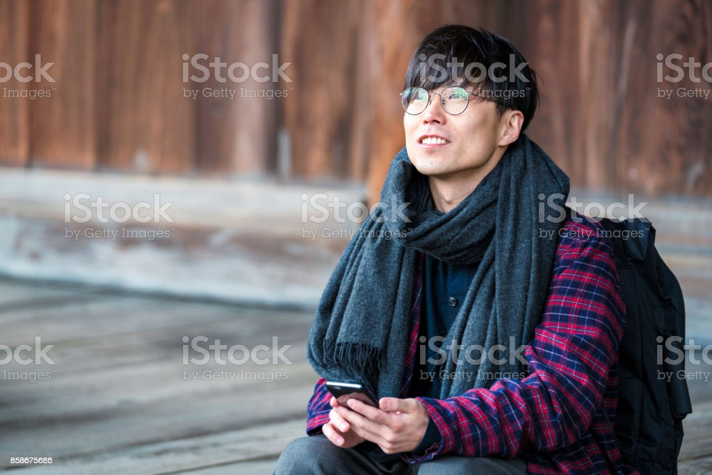 Japanese man sitting at Hyakumanben Chionji Temple stock photo
