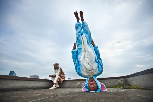 istock Japanese man standing on his head in elephant costume 143922200