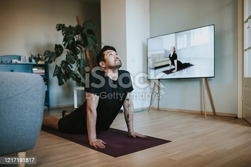 Photo series of stay-at-home fitness during lockdown in self isolation.