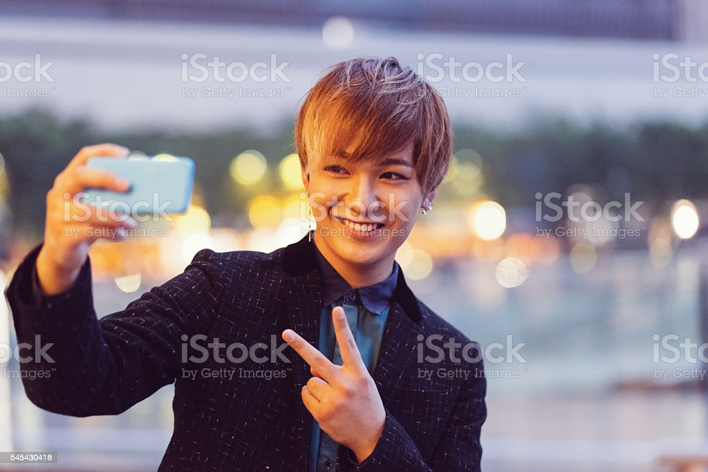 Japanese man taking selfie stock photo