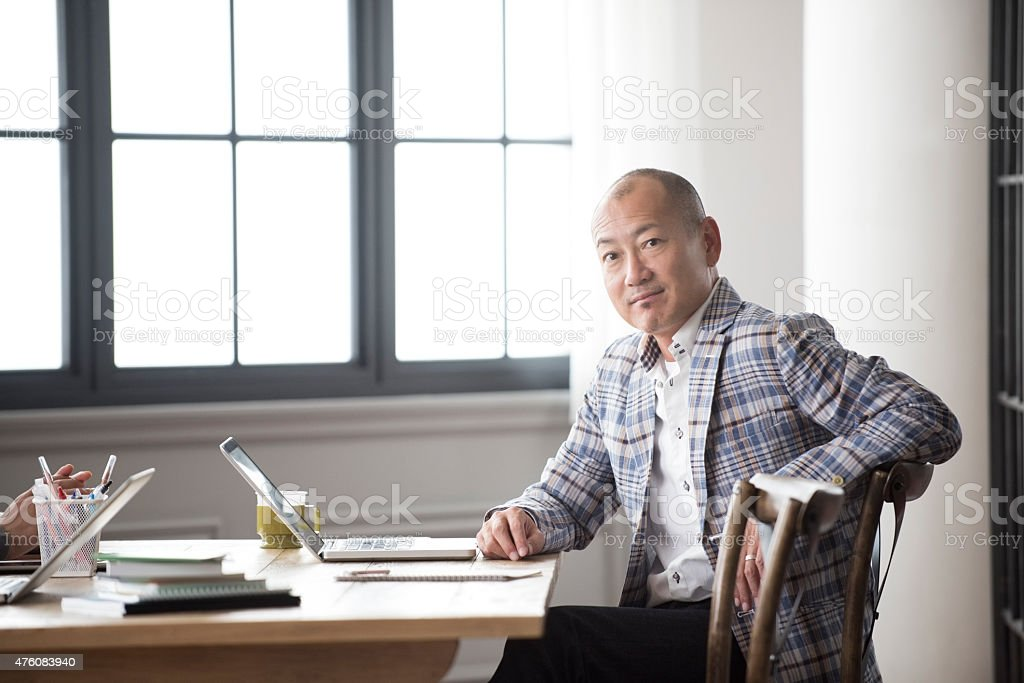 Japanese man with laptop portrait stock photo