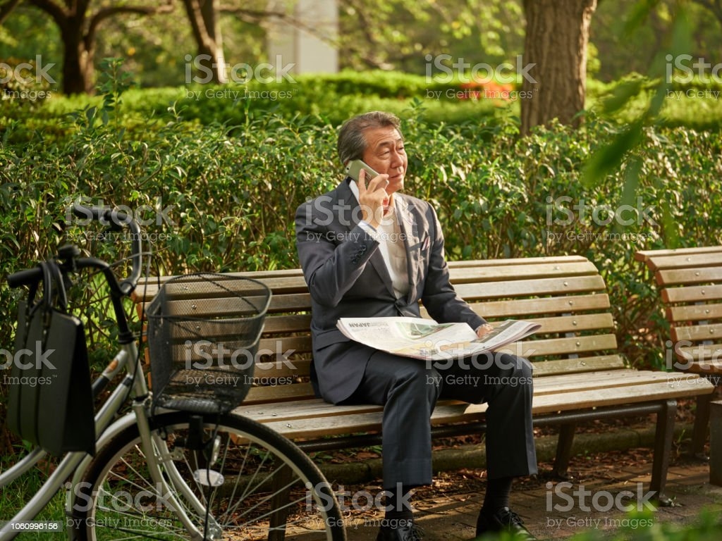 Japanese Man with Newspaper stock photo