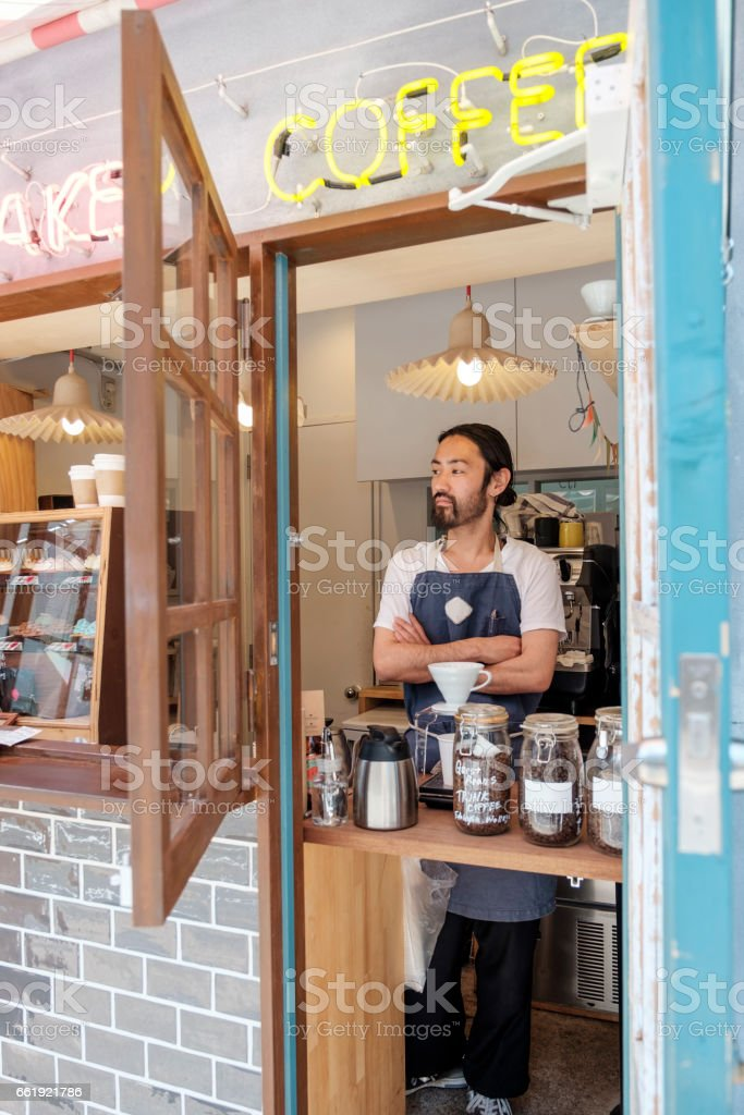 Japanese man working in a cupcake shop stock photo
