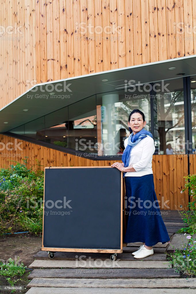 Japanese manager in front of coffee shop, Tokyo stock photo