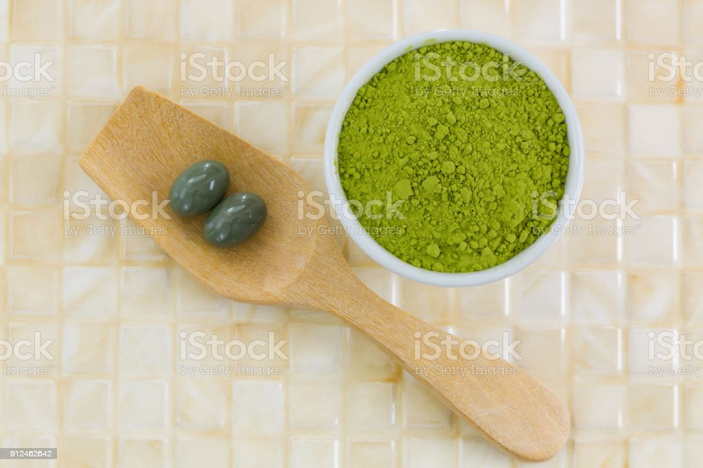 Japanese Matcha green tea powder, extracted Green tea concentrate in soft gel supplement capsule stock photo