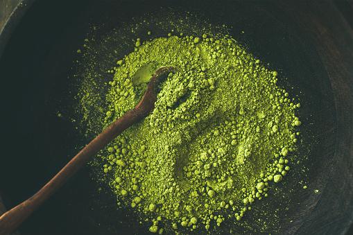 Japanese Matcha green tea powder in bowl, top view
