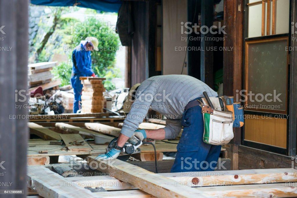 Japanese Men Work Construction Repairs of Historic Home Japan stock photo
