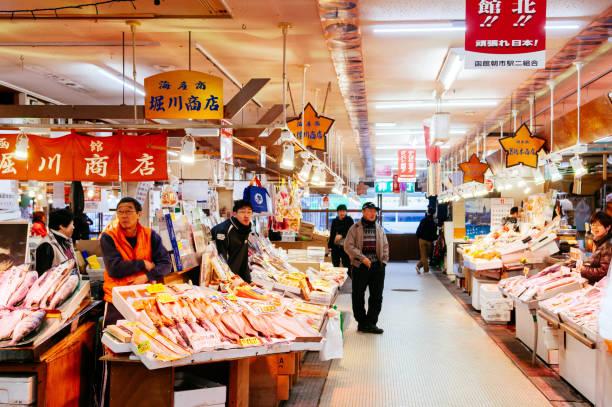 Japanese merchant at Hakodate morning fish market, famous market in Japan stock photo