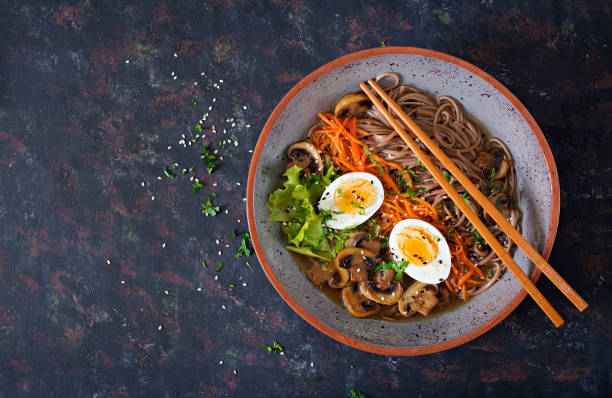 japanese miso ramen noodles with eggs, carrot and mushrooms. soup delicious food. flat lay. top view - pho soup stock photos and pictures