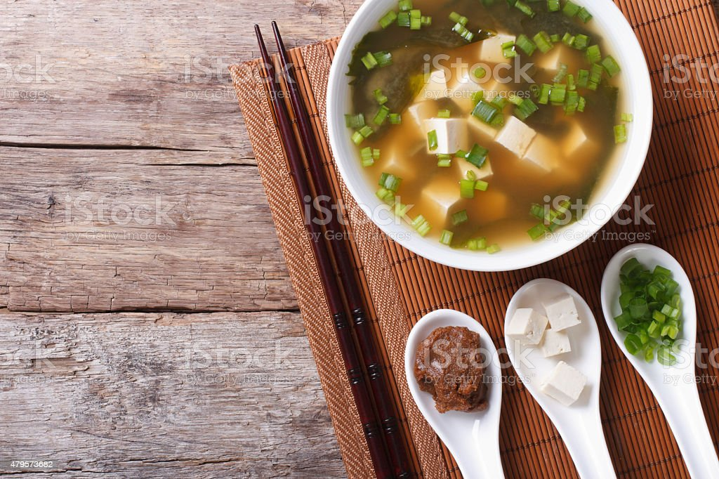 Japanese miso soup and ingredients. top view of a horizontal stock photo