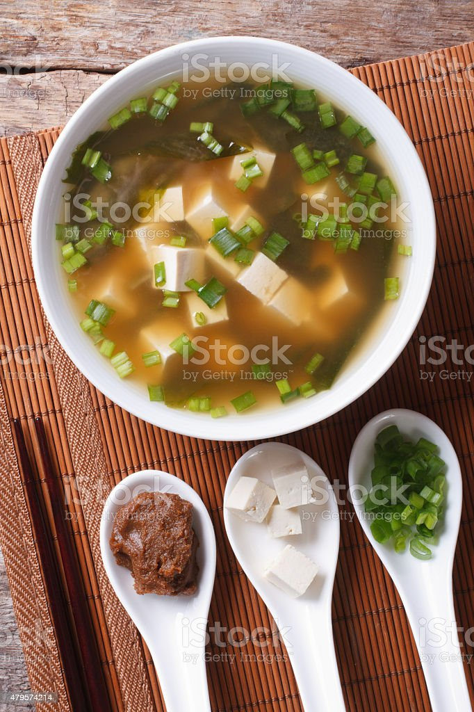 Japanese miso soup and ingredients. top view vertical stock photo