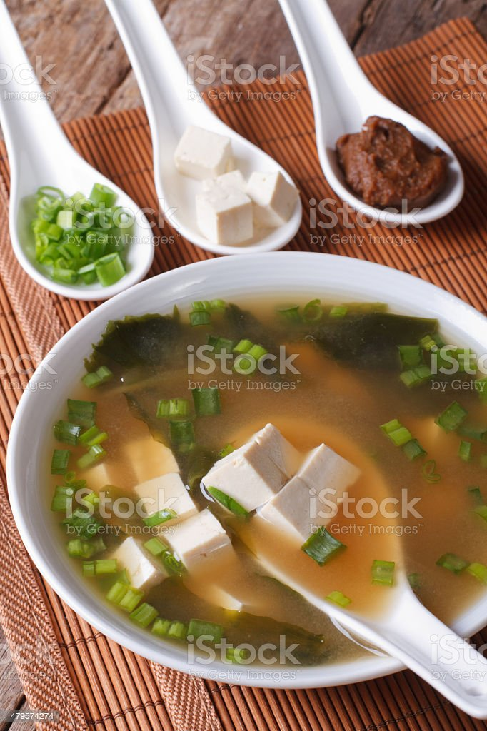Japanese miso soup in bowl with a spoon horizontal stock photo