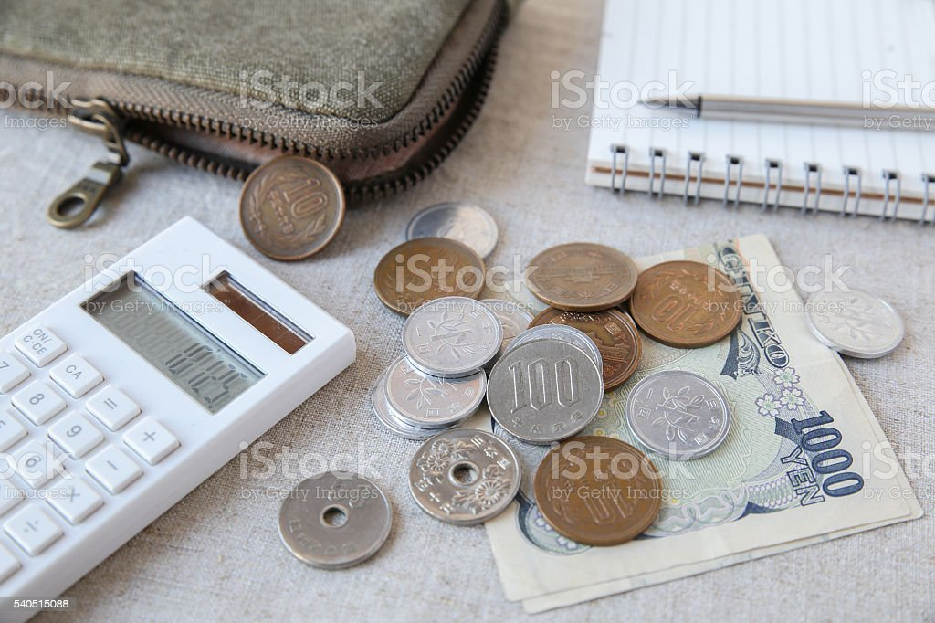 Japanese money Yen wtih calculator, notebook and pouch stock photo