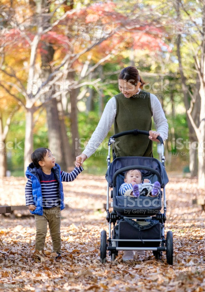 Japanese Mother and Children in the Park stock photo