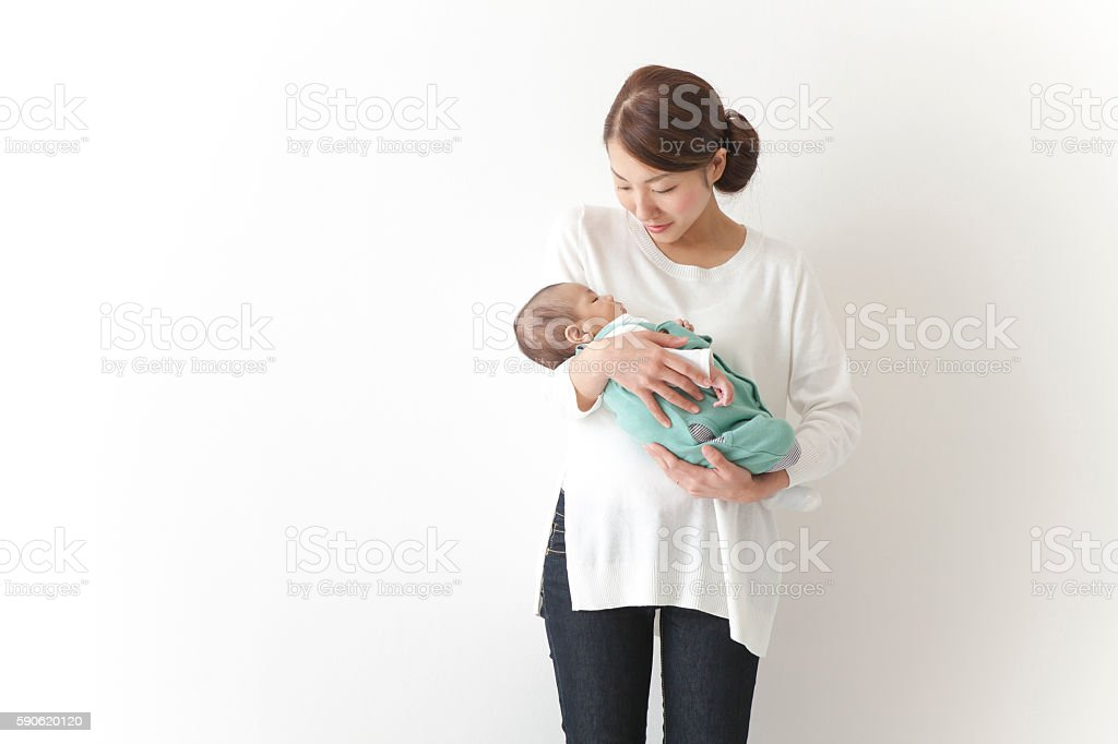 Japanese mother holding baby stock photo
