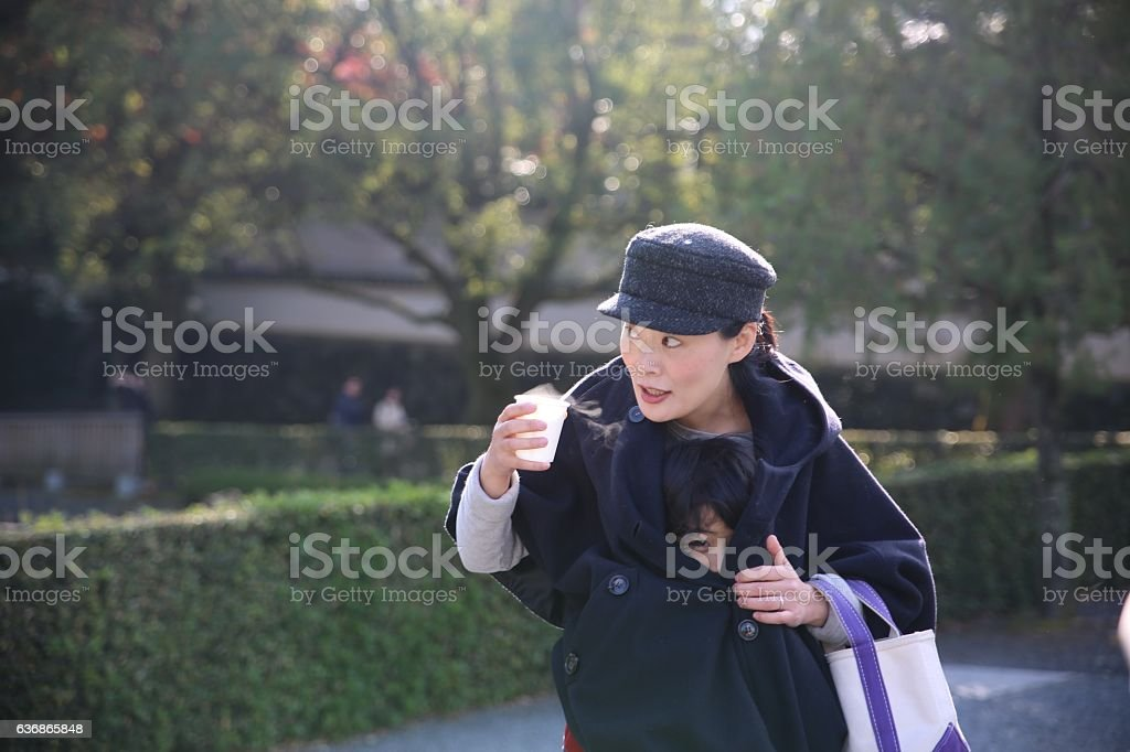 Japanese mother holding her child at Tofuku temple stock photo
