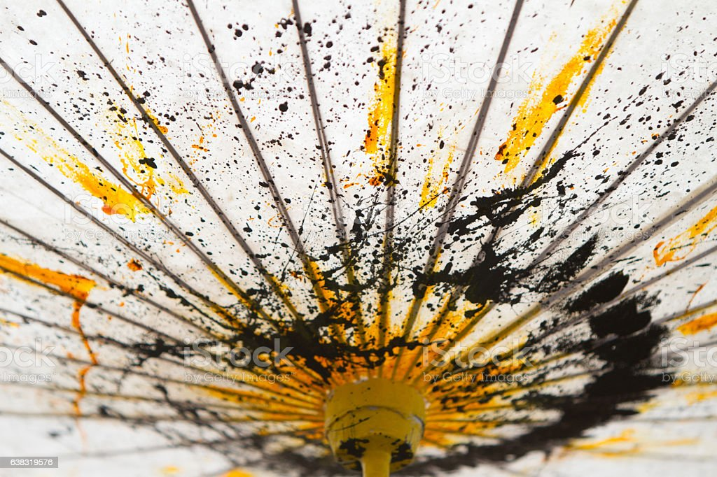 Japanese Mulberry Paper Umbrella Hand Painted with Yellow and Black. stock photo
