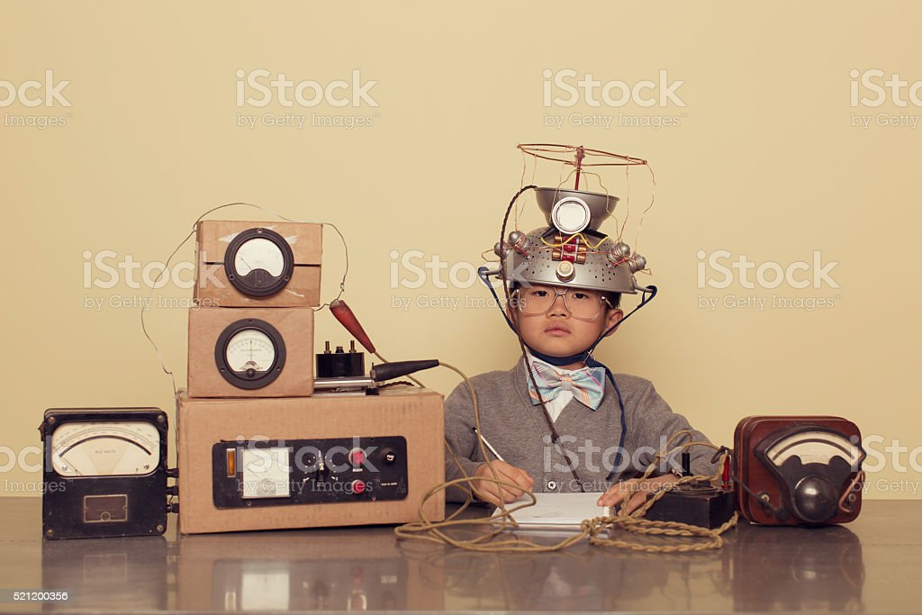 Japanese Nerd Boy Wearing Mind Reading Helmet stock photo