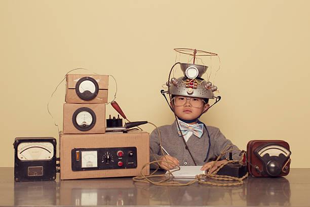 Japanese Nerd Boy Wearing Mind Reading Helmet stock photo