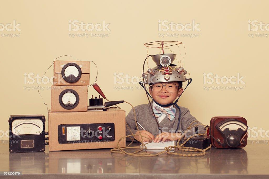 Japanese Nerd Boy Wearing Mind Reading Helmet royalty-free stock photo